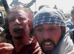 Video footage posted on the Internet showed an injured Qaddafi (left) in the custody of rebels