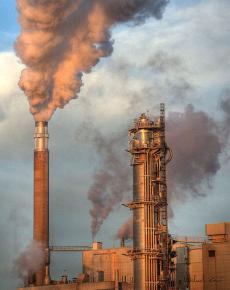 Pollution billows from the smokestack of a factory in Sweden
