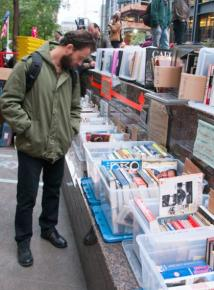 An occupier browses titles at the Occupy Wall Street library