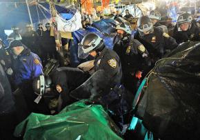 New York City police march through Zuccotti Park destroying the encampment