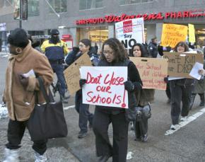 Teachers, parents and community activists march against Chicago public school closures
