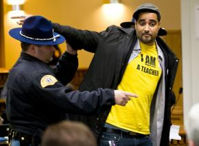 Jesse Hagopian escorted from a state legislature hearing after attempting a citizen's arrest of lawmakers