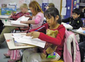Fourth graders work on a math test