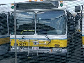 Public buses in Boston sit idle at a garage