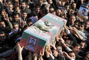 Mourners at the funeral for murdered nuclear scientist Mostafa Ahmadi Roshan