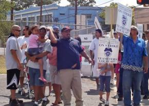 Teamsters and their supporters demonstrate for justice outside the C.H. Guenther & Sons flour mill