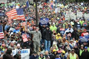 Union members and supporters mass around the Capitol building in Indianapolis to protest right to work legislation