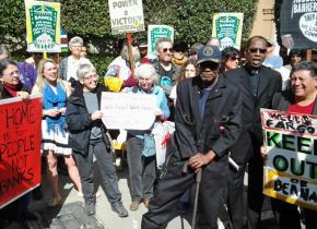 Activists in San Francisco deliver a foreclosure notice to Wells Fargo CEO John Stumpf