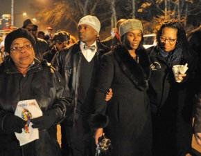 Danelene Powell-Watts (second from right) marches alongside supporters in a vigil for her son Stephon