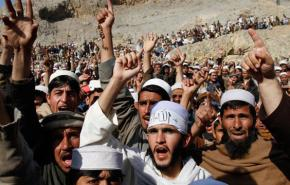 Afghans assemble in a mass protest in Ghani Khail