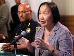 Oakland Mayor Jean Quan (speaking), while Police Chief Howard Jordan
