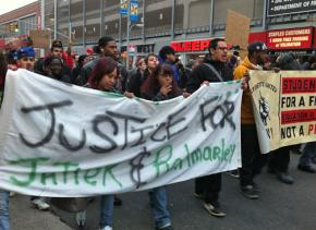 Demonstrators against police violence wound their way through a busy Bronx shopping area