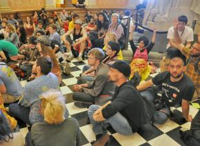 Protesters hold a discussion while sitting in at the California state Capitol building