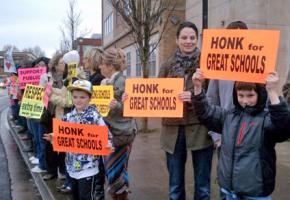 Students and teachers rally to defend public education at a Gresham-Barlow school