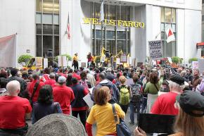 Hundreds march and rally outside a Wells Fargo shareholders meeting