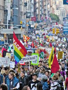 Labor, Occupy and immigrant rights activists join in a mass march in New York City on May Day