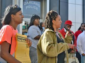 Protesters speak out for justice for Alan Blueford outside an Oakland police station