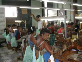 Cuban workers in cigar factory