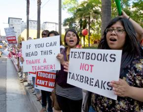 Teachers from the UTLA join community members to protest cuts to public schools