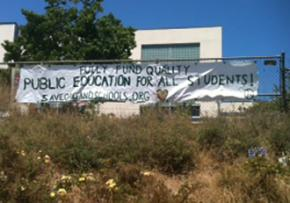 A banner hangs outside the sit-in at Lakeview Elementary in Oakland