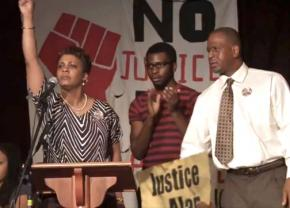Jeralynn and Adam Blueford (at left and right) onstage at a Bay Area meeting against police violence