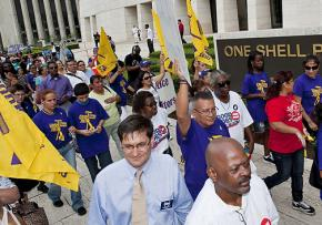 Houston janitors and their supporters march in front of One Shell Plaza