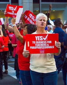 Chicago teachers rally support in the streets during a mass march in May