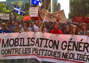 Protesters join in a massive march in Montreal on August 22