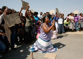 Protesters gather at the Lonmin mine following the massacre of workers by police