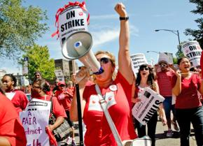 CTU members and supporters join in a mass march to Marshall High School on the West Side
