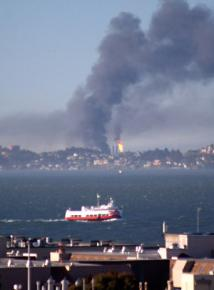 Smoke billows from the fire at a Chevron refinery in Richmond