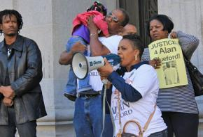 Alan's mother Jeralynn Blueford speaks on the steps of Oakland City Hall