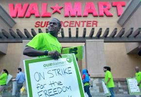 Striking Wal-Mart workers picket outside a store in Pico Rivera, Calif.