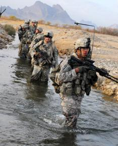 U.S. soldiers cross a stream during a security patrol in Chabar, Afghanistan
