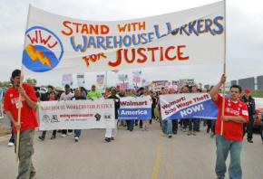 Hundreds of union and social justice activists march in solidarity with warehouse workers on strike against Wal-Mart