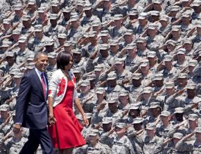 Barack and Michelle Obama are greeted by troops during a visit to Fort Stewart