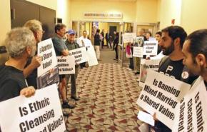 Protesters line the hallway outside the Stars and Stripes event