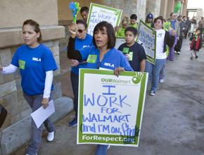 Workers and supporters picket outside a Wal-Mart in Southern California