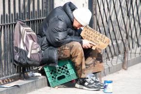 A man left homeless during the housing market crash sits at Broadway and 79th