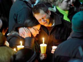 Families in Newtown mourn at a vigil for the children and teachers killed in the school shooting