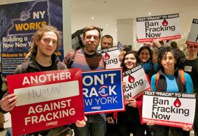 Anti-fracking protesters fill the lobby outside during Gov. Andrew Cuomo's State of the State speech