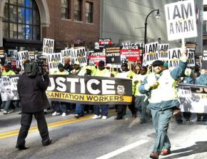 DeKalb County sanitation workers march down Peachtree Street in downtown Atlanta