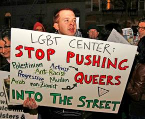 LGBT rights activists protest the center's former policy banning Palestine solidarity events