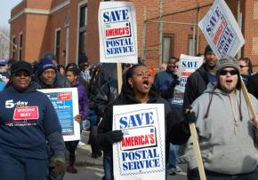 Letter carriers march on Obama's Chicago house to call for his support in stopping the elimination of Saturday service