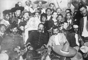 Pancho Villa (front row, second from left) poses with Emiliano Zapata (front row, third from left) in Mexico City