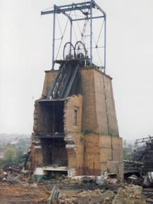 The half-demolished pithead to a coal mine in Barnsley during the 1984-85 miners' strike