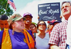 Immigrant rights supporters gather in a mass march on May Day