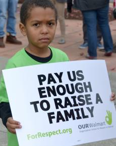 Wal-Mart workers and their families take part in the national Black Friday day of action in 2012