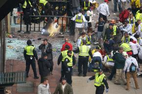 First responders tend to the injured following the Boston Marathon bombings