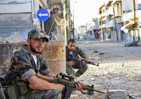 Syrian rebels on patrol when they controlled Qusair